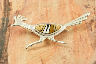 Beautiful Roadrunner Brooch featuring Genuine Picture Jasper, Magnesite and Black Jade inlaid in Sterling Silver.  Designed by Navajo Artist Calvin Begay. Signed by the artist.